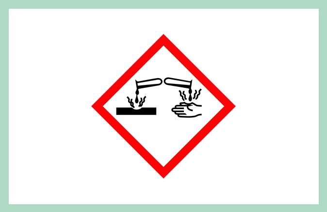 Symbool huishoudproduct corrosief bijtend